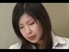 Shy busty Asian girl in nylons gets naked to rub her pussy