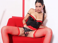 Skinny Latina Cici Amor strips off her stockings and lingerie before...