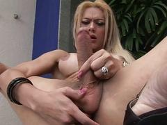 Sensual blonde shemale plays with her big dick