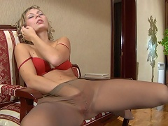 Heated girl strips to her silky hose and rubs her pink talking on the...
