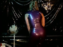 Latex Slave Suspended From The Ceiling