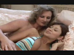 Bikini milf and babe join up in bedroom