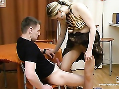 Frisky chick teasing guy with her pantyhosed legs till giving great legjob