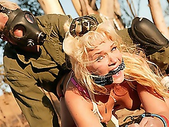 Breasty golden-haired and dead fucking gorgeous, Heidi Mayne just got even fucking hotter. Fastened and chained to a tree, Heidi's amazing round