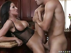 Sexy brunette wife Kortney Kane with long legs and big boobs uses her chance perfectly to seduce her husband's friend Danny Mountain. She turns h