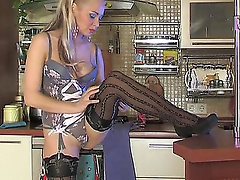 Lengthy-haired playgirl willingly putting off her striped nylons in the kitchen