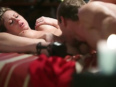 Candle light and semi-dark of the bedroom make Carolyn Reese's sex with her sexy buddy very romantic. This chab slowly pulls down her red belt an