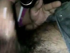 Hot Italian brunette sex worker with big slutty earrings and pink bra sucks a dick, whose cautious owner insisted on wearing a rubber, and then she sp