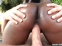 Dark skinned sweetheart Black Swan with wonderful large booty enjoys interracial hardcore sex outdoors. She rides dude's white dick and he keeps