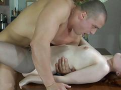 Pale redhead babe in grey pantyhose gets fucked doggy style in kitchen