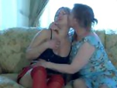 Young blonde in stockings and mature momma fingering each other