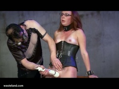 Tied up redhead slave in latex gets tortured