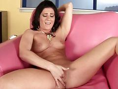Ariel spreads her long legs and rubs hard clit