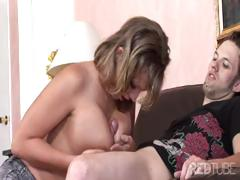 Nikki is a short-haired blonde with a pair of big breasts who fucked on a black sofa